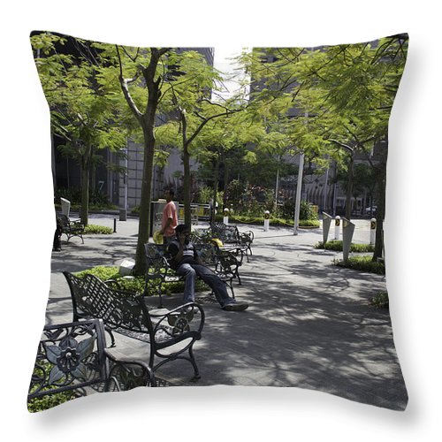 Action Throw Pillow featuring the photograph Sitting Place Inside Suntec City In Singapore by Ashish Agarwal