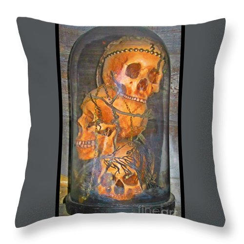 Skulls Throw Pillow featuring the photograph Skulls by Crystal Loppie