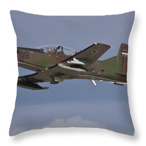 Czech Republic Throw Pillow featuring the photograph Slovenian Pc-9m Taking by Timm Ziegenthaler