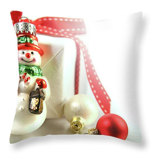 Background Throw Pillow featuring the photograph Small Christmas Ornament With Gift by Sandra Cunningham
