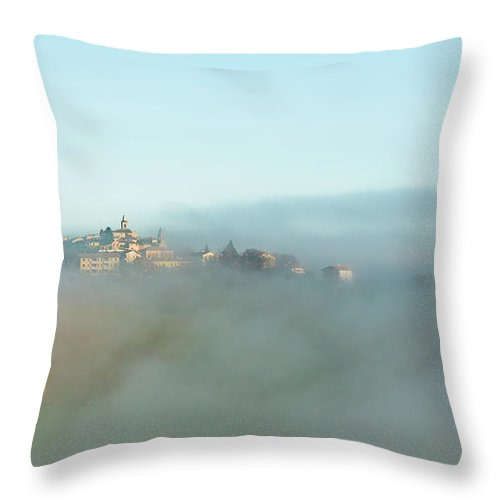 Scenics Throw Pillow featuring the photograph Small Italian Village In The Fog by Deimagine