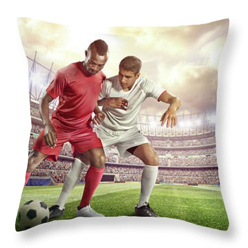 Soccer Uniform Throw Pillow featuring the photograph Soccer Player Tackling Ball In Stadium by Dmytro Aksonov