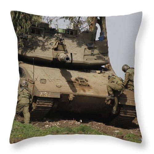 Battletank Throw Pillow featuring the photograph Soldiers Climb Into An Israel Defense by Ofer Zidon