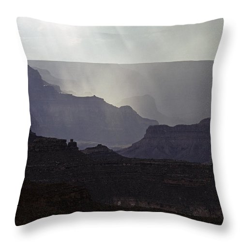Grand Canyon National Park Throw Pillow featuring the photograph South Rim Grand Canyon Storm Clouds And Sunray Light On Rock For by Jim Corwin