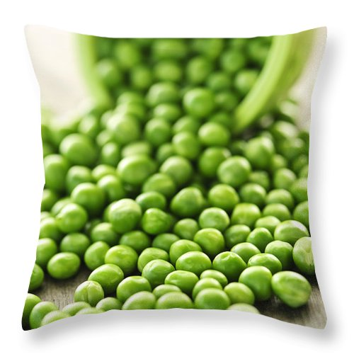 Peas Throw Pillow featuring the photograph Spilled Bowl Of Green Peas by Elena Elisseeva