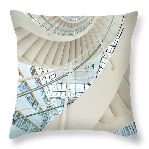 Steps Throw Pillow featuring the photograph Spiral Staircase Inside Office Complex by Blurra