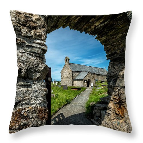 Anglesey Throw Pillow featuring the photograph St Patrick Arch by Adrian Evans