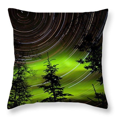 Astro Throw Pillow featuring the photograph Star Trails And Northern Lights In Sky Over Taiga by Stephan Pietzko