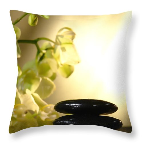 Orchid Throw Pillow featuring the photograph Stone Cairn And Orchids by Olivier Le Queinec