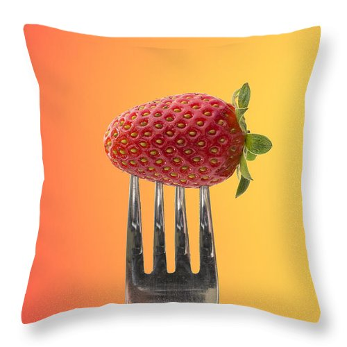 Background Throw Pillow featuring the photograph Strawberry On Fork by Paulo Goncalves