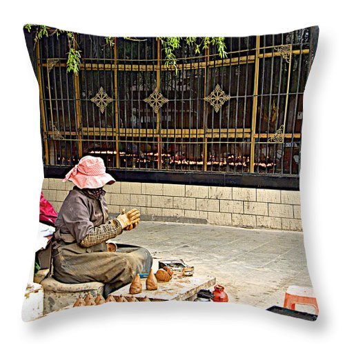 Street Shopkeeper In Lhasa Throw Pillow featuring the photograph Street Shopkeeper In Lhasa-tibet by Ruth Hager