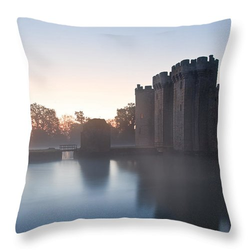 Castle Throw Pillow featuring the photograph Stunning Moat And Castle In Autumn Fall Sunrise With Mist Over M by Matthew Gibson