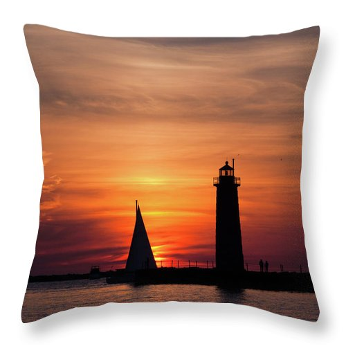 Sailboat Throw Pillow featuring the photograph Sun Set At The Muskegon Lighthouse by John Harmon