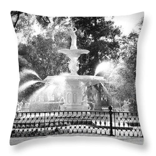 Savannah Throw Pillow featuring the photograph Sunlight Through Savannah Fountain With Vignette by Carol Groenen