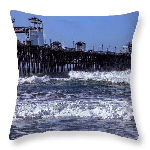 Oceanside Pier Throw Pillow featuring the photograph Surfer by Diana Powell