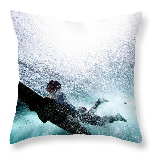 Expertise Throw Pillow featuring the photograph Surfer Duck Diving by Subman