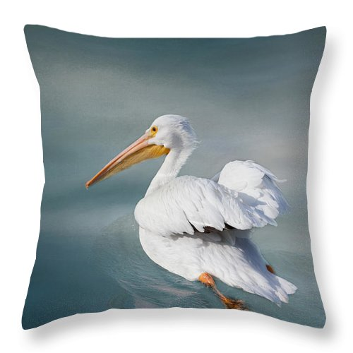Pelican Throw Pillow featuring the photograph Swimming Away by Kim Hojnacki