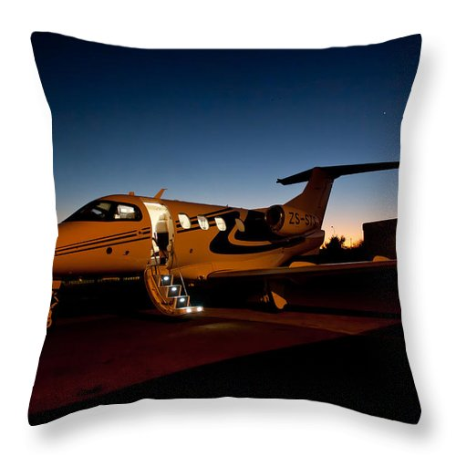 Embraer Phenom 100 Throw Pillow featuring the photograph Switching Off by Paul Job
