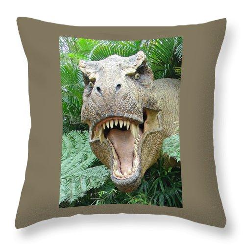 Islands Of Adventure Throw Pillow featuring the photograph T-rex by David Nicholls