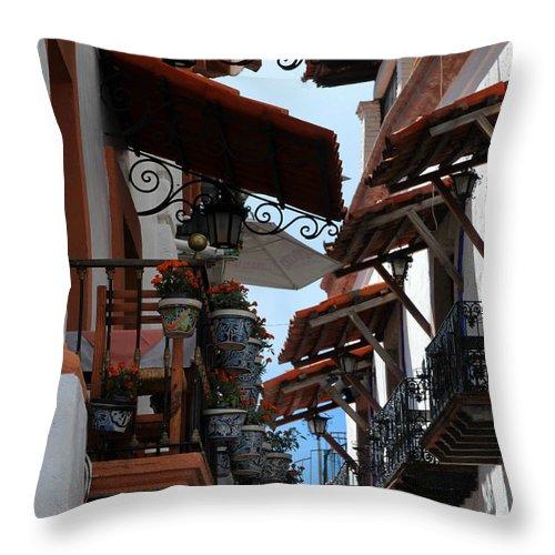 Balconies Throw Pillow featuring the digital art Taxco Balconies by Juan Miranda
