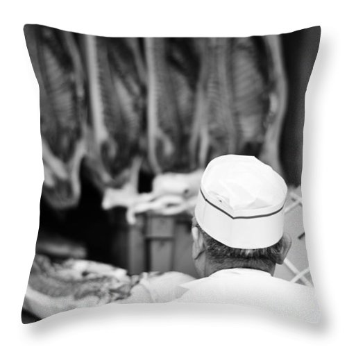 Vancouver Throw Pillow featuring the photograph The Butcher by The Artist Project