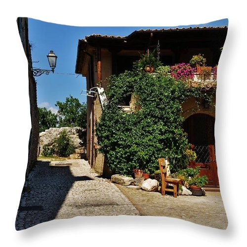 Street Throw Pillow featuring the photograph The Charming Patio by Dany Lison