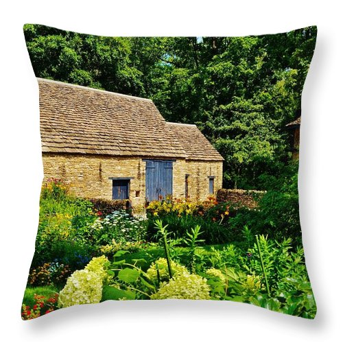 Barn Throw Pillow featuring the photograph The Cotswald Barn And Dovecove by Daniel Thompson