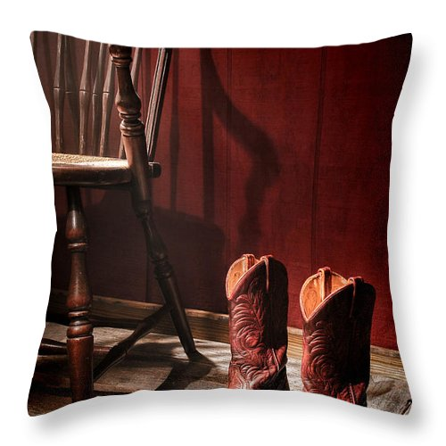 Cowgirl Boots Throw Pillow featuring the photograph The Cowgirl Boots And The Old Chair by Olivier Le Queinec