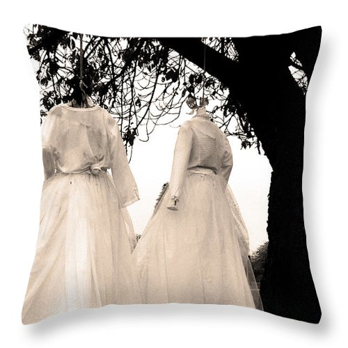 Black And White Throw Pillow featuring the photograph The Hanging Brides by The Artist Project