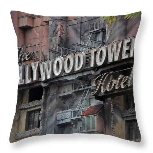 Magic Kingdom Throw Pillow featuring the photograph The Hollywood Hotel Signage by Thomas Woolworth