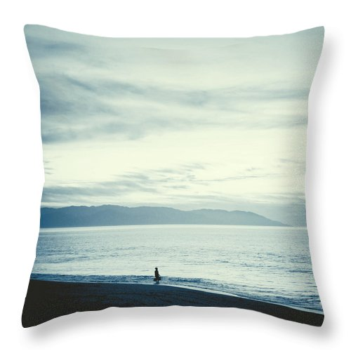 Ocean Throw Pillow featuring the photograph The Lonely Fisherman by Natasha Marco