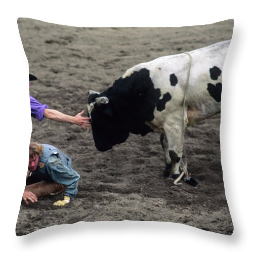 Bullfighter Throw Pillow featuring the photograph Rodeo The Magic Touch by Bob Christopher