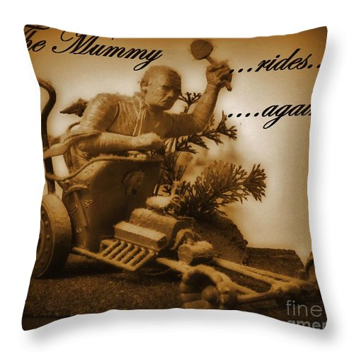 Nightmares Throw Pillow featuring the photograph The Mummy Rides In Halifax by John Malone