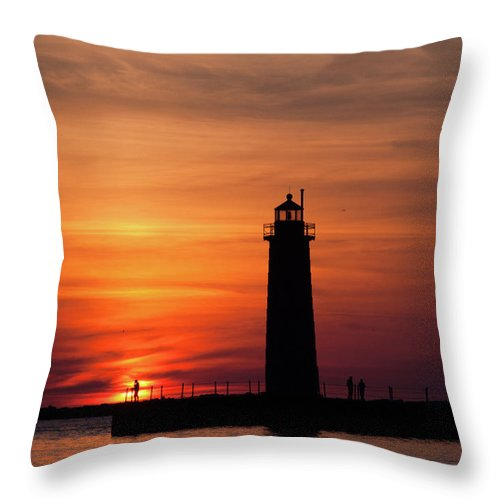 Nautical Throw Pillow featuring the photograph The Muskegon Lighthouse An A Lone Man Fishing by John Harmon