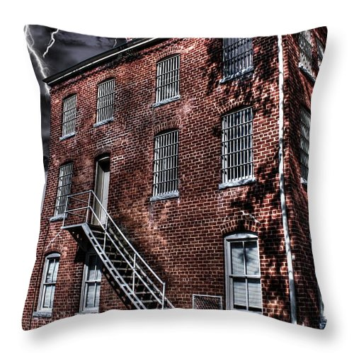 Abandoned Throw Pillow featuring the photograph The Old Jail by Dan Stone
