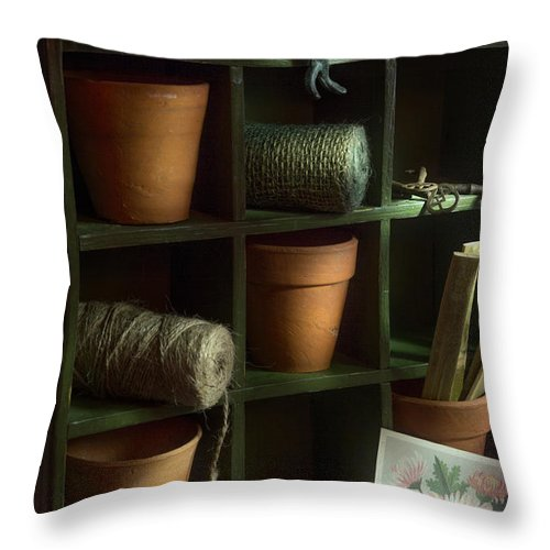 Potting Shed Throw Pillow featuring the photograph The Potting Shed by Ann Garrett