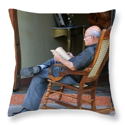 Central Throw Pillow featuring the photograph The Reader by Rudi Prott