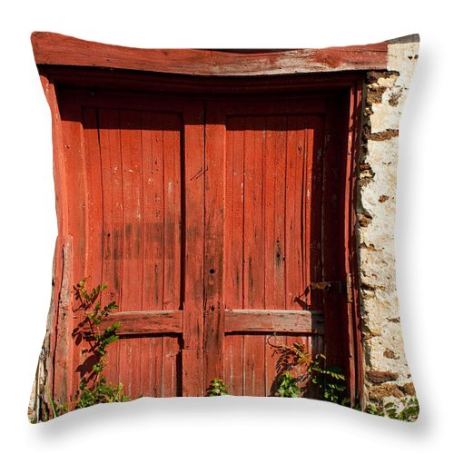 Pleasant Mills Throw Pillow featuring the photograph The Red Mill Door by Kristia Adams