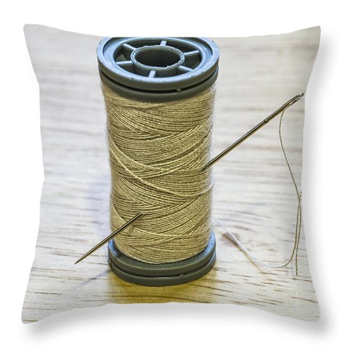 Background Throw Pillow featuring the photograph Thread And Needle by Paulo Goncalves