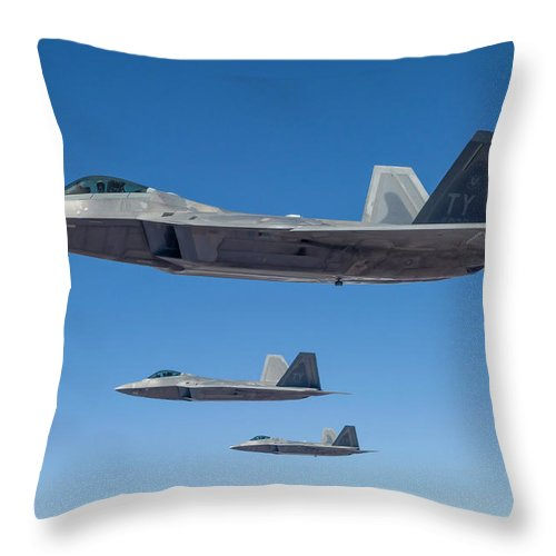 Formation Flying Throw Pillow featuring the photograph Three U.s. Air Force F-22 Raptors by Rob Edgcumbe/stocktrek Images