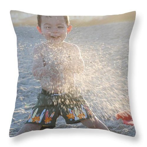 Boy Throw Pillow featuring the photograph Throwing Sand by Saralyn Cumberledge