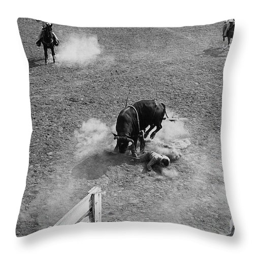 Thrown Bull Rider Rodeo Tohono O'odham Reservation Sells Arizona 1969 Throw Pillow featuring the photograph Thrown Bull Rider Rodeo Tohono O'odham Reservation Sells Arizona 1969 by David Lee Guss