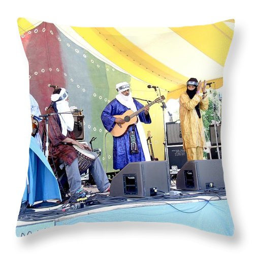 Tinariwen Throw Pillow featuring the photograph Tinariwen by Concert Photos