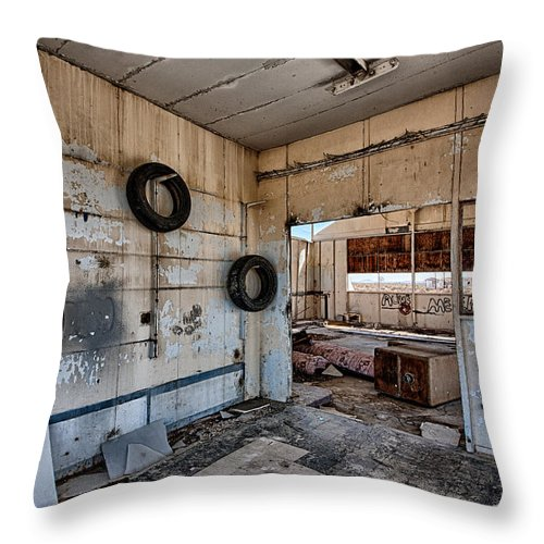 Gas Station Throw Pillow featuring the photograph Tired Building by Peter Tellone