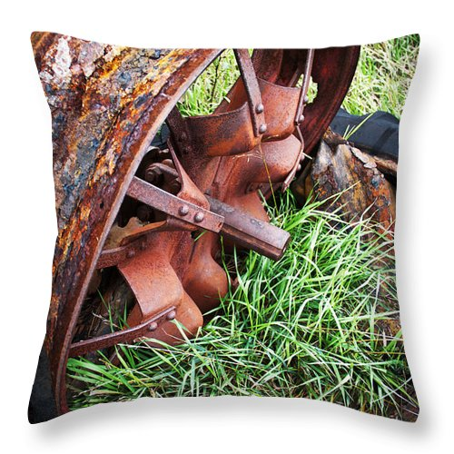 Tractor Throw Pillow featuring the photograph Ferrous Wheel by Guy Shultz