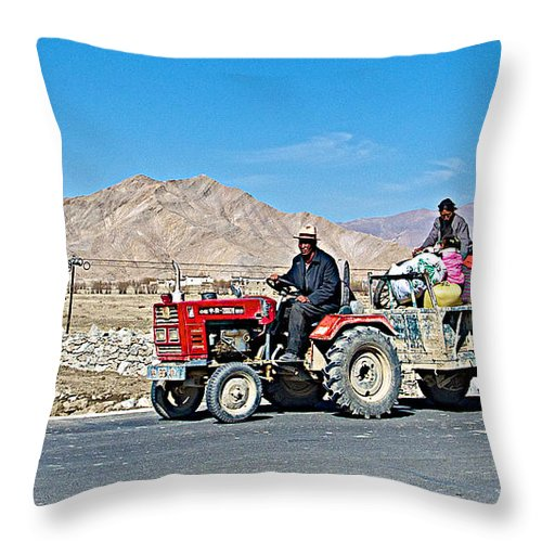 Tractor Towing A Wagon Along The Road To Shigatse Throw Pillow featuring the photograph Tractor Towing A Wagon Along The Road To Shigatse-tibet by Ruth Hager