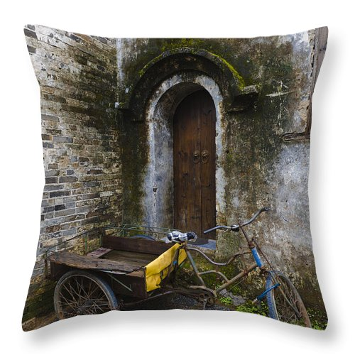 Tricycle Throw Pillow featuring the photograph Tricycle Parked In Alleyway by John Shaw