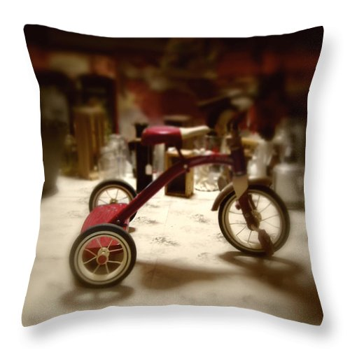 Antique; Childhood; Toy; Tricycle; Bike; Radio Flyer; Heirloom; Nostalgia; Old; Retro; Vintage; Miniature; Lighting; Dark; Darkness; Shadows; Eerie; Creepy; Lost Throw Pillow featuring the photograph Trike by Margie Hurwich