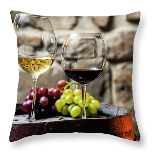 Alcohol Throw Pillow featuring the photograph Two Glasses Of Red And White Wine In by Piranka