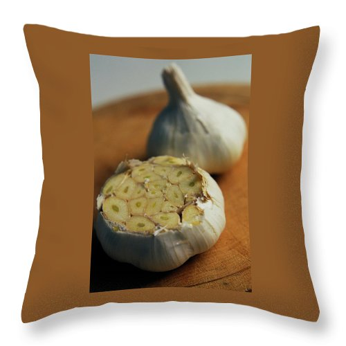 Fruits Throw Pillow featuring the photograph Two Heads Of Garlic by Romulo Yanes